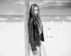 Nothing Is Real But The Girl (Steve Lundqvist) Tags: sea portrait bw beach girl monochrome leather fashion sand mare dof moda pole jacket shorts ritratto spiaggia ragazza