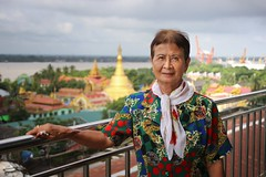 Grandma Bunrod at the skyriver restaurant in Yangon (Bn) Tags: road street old city family portrait people haven car sunshine umbrella hair temple gold cycling hotel harbor pagoda high topf50 gate locals traffic buddha candid yangon burma stupa buddhist taxi colonial bikes monk millenium capitol transportation infrastructure million myanmar years former six buddism birma destroyed religions hollow seaport rebuild township 2500 slums rangoon pilgrims dazzling overwhelmed entree botahtaung 40m gautama 50faves botataung skyriver kyats fietstaxi botatuang 1000militaryofficers