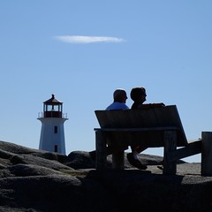 Life is wonderful (halifaxlight) Tags: cloud lighthouse canada bench square couple rocks novascotia shadows silhouettes sunny peggyscove seashore enjoyment