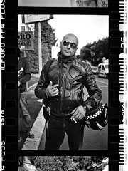 Edo (Luca Rossini) Tags: portrait man film sunglasses 35mm voigtlander bessa helmet jacket frame plus r2 ilford fp4 f25 bold colorskopar iso125 voigtlandercolorskopar35mmf25