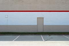 Indy#8594_Copy (Single-Tooth Productions) Tags: door city urban building lines architecture composition 50mm nikon architecturaldetail stripes indianapolis buildingdetail shapes indiana minimal doorway minimalism nikkor parkingspots browndoor concreteblock nikond200 nikkor50mmf18daf exteriorwall nwside architecturalcomposition exteriorwallcomposition paintedconcreteblock buildingcomposition