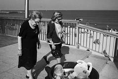 elderly ladies having a stroll (gorbot.) Tags: barcelona street blackandwhite bw candid barcelonetta f19 leicam8 digitalrangefinder ltmmount voigtlander28mmultronf19 siverefex