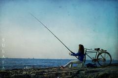 My friend Rafeef fishing (Sulafa) Tags: fishing   blinkagain