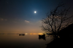 Claire de lune (ChrisBrn) Tags: city sky moon lake tree silhouette night clouds stars lights calm national moonlight geographic