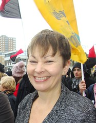 Caroline Lucas MP, surrounded  by anarchist flags (brightondj) Tags: uk green march brighton protest demonstration strike unions mp n30 greenparty anarchists tradeunions carolinelucas november30thstrike