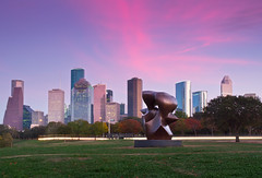 Houston Texas Skyline (Jim Boud) Tags: pink blue trees sunset sky sculpture statue skyline skyscraper buildings landscape cityscape texas purple dusk pastel houston lighttrails houstontexas lightroom artisticphotography buffalobayou jimboud canoneos60d jamesboud canonefs1585mmf3556isusm canon1585mm