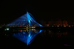 Seri Wawasan Bridge, Putrajaya In Reflection (Haryth Hayqal) Tags: lighting bridge blue light color reflection building nature water night led slowshutter shutter colourful putrajaya longshutter seri wawasan balb seriwawasanbridge favescontestwinner doubleniceshot tripleniceshot mygearandme mygearandmepremium mygearandmebronze mygearandmesilver mygearandmegold mygearandmeplatinum mygearandmediamond ringexcellence dblringexcellence