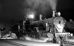 New South Wales Government Railways 4-6-0 steam locomotive 3224 night time at the locomotive depot at Enfield, Sydney, N,S.W. Australia.
