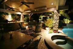 Enchanting Outdoor Lighting by Land Mechanics, Inc. (Landscape Design Advisor) Tags: california ca orange green landscaping swimmingpool palmtrees southerncalifornia orangecounty shrubbery landscapedesign outdoorfurniture outdoorkitchen outdoorlivingroom outdoorspace stonepatio outdoorlighting stonepavers landscapedesigner greenferns landscapelighting northorangecounty poollighting outdoordiningroom coveredpatio landscapecontractor patiolighting poolsidedining poolsidepatio outdoorlightingdesign backyardlighting landmechanicsinc outdoorkitchenlighting coveredoutdoorlivingroom patioceilingfans alfrescodiningroom