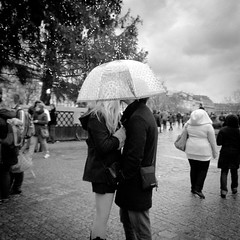 Sous le Parapluie (Airicsson) Tags: christmas street urban blackandwhite bw paris love rain analog umbrella vintage lumix kiss bokeh notredame panasonic g3