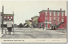 North FIfth Street, North Vernon, Indiana (Hoosier Recollections) Tags: horses people woman usa signs man color men history industry buildings walking advertising awning clothing women indiana streetscene transportation shops pedestrians storefronts buggy buggies businesses railroads barbers jenningscounty northvernon hoosierrecollections