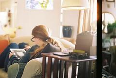 Cait on her iPad (Jason Jiron) Tags: jason film minolta x700 jiron