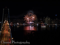 Bursts of Orange (ChasedPhotography) Tags: ocean california longexposure bridge sky water night lights pier fireworks baybridge embarcadero bayarea newyearseve newyears sfbayarea loud suspensionbridge sanfransisco 2012