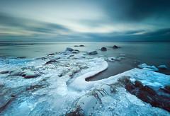 Frozen shore (- David Olsson -) Tags: longexposure blue winter lake cold ice nature water landscape nikon rocks sweden stones january freezing sigma le 1020mm 1020 vnern 2012 vrmland ndfilter lakescape d5000 takene davidolsson hammarsydspets hitechprostop10 ginordicjan12 hitech09softgnd