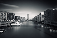 Model City (Philipp Klinger Photography) Tags: longexposure bridge blue light shadow red orange sun plant water glass lines architecture modern triangles skyscraper canon reflections river germany boats deutschland boot pier boat am t