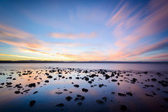 Little Nuggets (ajecaldwell11) Tags: light sunset newzealand sky reflection water clouds rocks dusk tide pacificocean ankh napier hawkesbay caldwell hawkebay foehn ahuriri