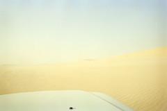 Sandy Mad Dogs II (Doha Sam) Tags: slr 35mm nikon jon kodak scan negative sandstorm 400 analogue wilderness fe portra manualfocus qatar nissanpatrol sealine nikonscan filmiso400 coolscan9000ed southerndesert newportra samagnew smashandgrabphotocom linearscan wwwsamagnewcom