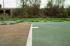 (pop archaeologist) Tags: park city film overgrown grass canon landscape highway kodak pavement michigan staircase cracks flint basketballcourt expiredfilm 28105 portra160nc eosa2