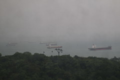 Ships in the Port of Singapore from the Sentosa Island (Singapore - May 14, 2016) (cseeman) Tags: rain boats harbor singapore waiting ships cargoships cargo rainy containership tankers oiltanker cmacgm crudeoiltanker singaporestrait tradingcenter singaporeharbor portofsingapore cmacgmchopin cmacgmlines rickmersgroup singapore2016 singaporetrading spiritofbangkok