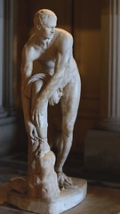 Hermes fastening his sandal, so-called Cincinnatus. Pentelic marble. Roman copy of the 2nd cent. CE after a Greek original by Lysippos of the 4th century BCE. Paris, Louvre Museum. (mike catalonian) Tags: sculpture louvre fulllength marble hermes copy cincinnatus 2ndcenturyad lysippos greekmodel