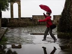 P9170301 Spain Basque Country San SebastianSan Sebastian (Dave Curtis) Tags: red rain umbrella puddle jump spain europe olympus sansebastian basque omd 2013 em5