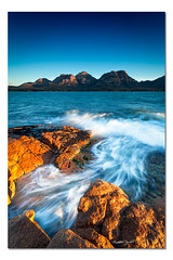 The Hazards (iii), Coles Bay, Tasmania (Matthew Stewart | Photographer) Tags: ocean light sunset sea sky orange white seascape beach water yellow rock bay movement rocks matthew australia stewart tasmania peninsula hazards coles freycinet 011222011
