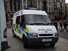 Met Police Transit (kenjonbro) Tags: uk 2002 white london ford march protest trafalgarsquare demonstration transit van minibus pensions kenjonbro fujihs10 pensionprotestmarchlondon30thnovember2011 lx51goa
