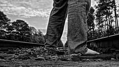 337/365: Jumping Someone Else's Train (basselal) Tags: bw feet monochrome train legs low tracks barefoot project365 canonefs1755mmf28isusm photospecs 337365 photoeditingstyle 3652011