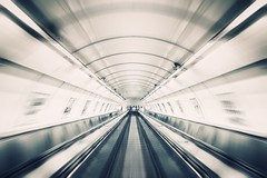 Tunnel (Philipp Klinger Photography) Tags: old urban bw white man motion black blur lines architecture stairs speed ads subway point person town vanishingpoint blackwhite high movement key europe pattern republic prague bright metro zoom geometry escalator ad tube prag tunnel praha praga down tschechien tschechischerepublik symmetry line motionblur stare czechrepublic symmetrical highkey railing vanishing altstadt oldtown brightness ceskarepublika republika staremesto symmetrie mesto ceska czechy tschechei czec prask hlavnimestopraha praskmetro