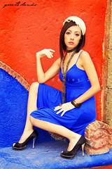 Contrast of Age (daviesg) Tags: blue portrait sun black abandoned girl hat wall contrast pose mexico crossprocessed model mexicocity sitting dress flash feathers retro jewellery gloves theme brunette mirada reflector satelite studiolighting abandonedbuilding estadodemexico calacoaya