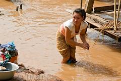 Laundry time (tiabunna) Tags: people woman river laundry laos mekong pentaxk10d
