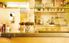 Café 222 (isayx3) Tags: film café field yellow 50mm muffins cafe nikon dof open sandiego bokeh grain wide retro nikkor studios tones depth d3 bobbyflay foodnetwork 14g hbw plainjoe isayx3 plainjoephotoblogcom vscofilm
