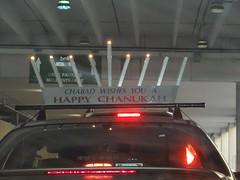 Chabad wishes you a Happy Chanukah (Joe Architect) Tags: car sign mall nc triangle chanukah favorites northcarolina raleigh odd hanukkah crabtree menorah yourfavorites 2011 crabtreevalleymall