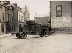 Armoured Car, Passage West, Cork (National Library of Ireland on The Commons) Tags: 1920s ireland cork august crest pistol posters soldiers sunburst 1922 troops munster fitzgerald peerless freestate armoredcar twenties armouredcar streetfighting passagewest nationallibraryofireland irishcivilwar nationalarmy housefurnishers provisionmerchants wdhogan hogancollection britishtankcorps passagewestpostoffice