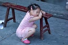 Shanghai girl (skowalczuk) Tags: poverty china street sleeping girl children asia shanghai chinese daily dozen ngm 2012janweek2
