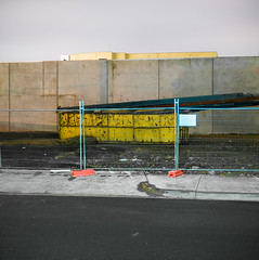 Landscape (Dr Abbate) Tags: street longexposure urban building wall night dumpster fence square site construction pavement container skip footpath