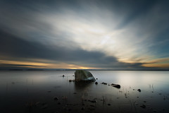 Centered rock (- David Olsson -) Tags: longexposure winter sunset lake cold nature water clouds landscape sticks nikon rocks cloudy sweden january sigma pebbles karlstad le 1020mm 1020 vnern 2012 bigrock vrmland blueandyellow ndfilter lakescape smoothwater d5000 bomstad davidolsson nd500 lightcraftworkshop 2exposuremanualblend ginordicjan12 centeredrock