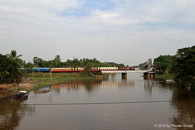 Express train to Mawlamyaing pulled by DF 1627 (Alsthom 1978) on lifting bridge in Waw