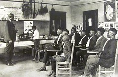Berry O'Kelly School, Early 1900s (Universal Pops) Tags: black students businessman photo education chairs classroom northcarolina raleigh teacher elementaryschool barefoot posters africanamerican method citypark philanthropist housingproject segregation wakecounty vocational trainingschool industrialarts accredited raleighcitymuseum berryokelly
