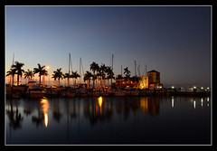 Twin Dolphins after Sunset (Javier Huanay) Tags: luz silhouette night marina reflections atardecer pier agua aqua florida twin dolphins javier bradenton d7000 huanay