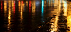 Urban Meditation (Philocycler) Tags: chicago reflection rain bokeh michiganave canon50mm14 reflectivelights urbanmeditation dreeam canonrebelt2i