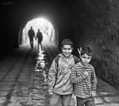 Friendship - 2 (Ben Heine) Tags: poverty life street houses windows light portrait people blackandwhite cute home boys monochrome smile childhood architecture portraits walking children happy hope friend mood doors cityscape friendship tunisia pavement homeless persp