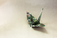 Origami crane (flaminghead Park) Tags: japan vertical closeup cutout paper photography tokyo origami decorative nopeople whitebackground papercrane studioshot folded shape japaneseculture skill threedimensional singleobject intricacy artandcraft colorimage highangleview signsandsymbols