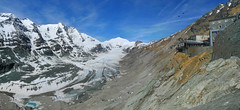 Classic view on the Pasterze Glacier and 3798m Groglockner (Bn) Tags: road blue sun mountains alps salzburg classic ice nature geotagged restaurant austria oostenrijk back sterreich nationalpark high topf50 force altitude centre famous curves carinthia tourist panoramic cliffs glacier alpine massive motorcycle winding kaiser longest visitors gletscher brochure viewpoint chough impressive hairpin attraction eternal hohe highest grossglockner hochalpenstrasse gletsjer pasterze johannisberg tauern hhe motorists 50faves winkl heiligenblut 9km josefs grosglockner 3798m panview sonnenwelleck freiwandeck naturschau geo:lon=12750570 geo:lat=47075303