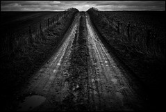 it's a long way to nowhere when despair settles in.. (kurtgrng) Tags: road way long 28mm nowhere down dirt when despair salisbury f22 sets muddy stopped in f6 orion15