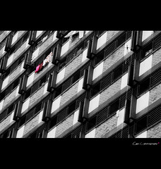 laundry i (Chez C.) Tags: life street city urban white abstract black building monochrome architecture design pattern flat olympus laundry ipoh spotcolor streetshot selectivecolor 150mm epl2