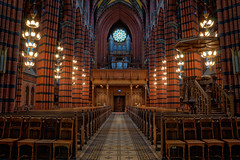 St. Johannes Church II (Henrik Sundholm.) Tags: door brick church architecture painting religious lights candles floor chairs sweden stockholm path interior bricks columns christian aisle organ sverige ladder benches pillars confessional hdr norrmalm johanneskyrka perspectivedistortion paintedwindow nygotisk
