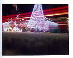 high traffic christmas decorations (EllenJo) Tags: longexposure family holiday night polaroid florida visit fujifilm fla pathfinder bsetting christmastrip polaroidlandcamera instantfilm thevillages fp100c 1minuteexposure ellenjo thevillagesflorida ellenjoroberts december2011 rollfilmcameraconvertedtopackfilm 32162 visitingtheroberts retirementcity