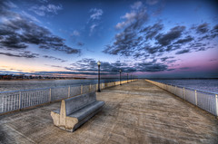 The Lonely Pier (Frank C. Grace (Trig Photography)) Tags: sunset sky seascape bench ma concrete harbor pier massachusetts magenta lonely lamps hdr newbedford forttaber tonemapped fortrodman butlerflatslighthouse trigphotography frankcgrace