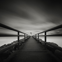 Lost Horizon (Jeff Gaydash) Tags: longexposure blackandwhite water pier seascapes michigan jetty symmetry photomerge lakescapes